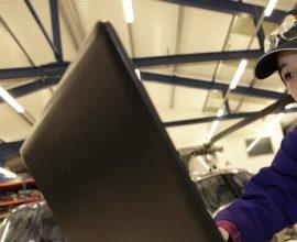 female engineer looking at laptop